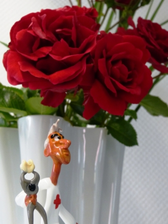 Glasmann mit Rose1 Homepage